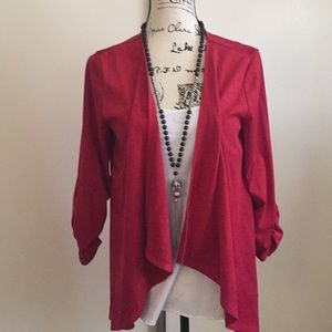 Woman's red jacket.